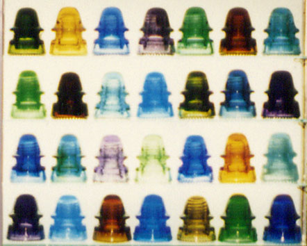 Close-up of Display of CD 162 Signal Glass Insulators in All Colors