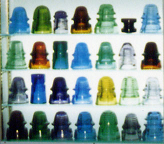 Close-Up Shot of Display of Colorful Glass Insulators in Different Shapes and Sizes
