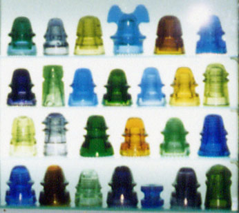 Close-Up Shot of Display of Colorful Glass Insulators in Different CDs