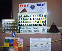 Fire and Ice Display of Cool Blues and Greens and Hot Reds and Oranges in Glass Insulators